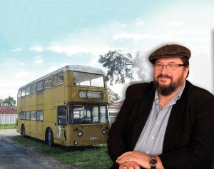 John Donoghue with the 1975 bus he plans to convert to a mobile cafe.