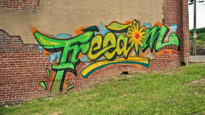 Freedom graffitied on a park wall