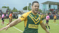"Hayne performing the ""Hayne Plane"" celebration while playing for the Australian Prime Minister's XIII in 2013."