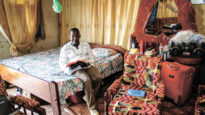 Edward Kajivora from Bible Society South Sudan in his home in Juba, with his Bible