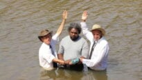 Lance Duggie is baptised by Pastors Don Fehlberg, left, David Gilmore.
