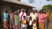 Lois Nadjamerrek (centre, in white) on the day of her ordination in 2013, West Arnhem Land.