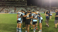 NRL players praying after a match.