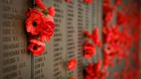 Red poppies line the Wall of Honour at the Australian War Memorial in Canberra
