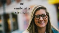 8smile-at-a-stranger-cover_1000x563_acf_cropped