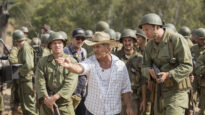 Mel Gibson directs actors on the set of Hacksaw Ridge