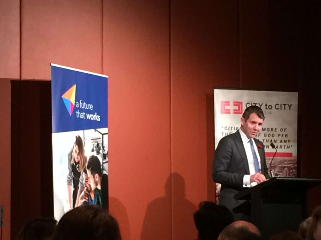 NSW Premier Mike Baird addresses the crowd at the City to City Renewing My Workplace conference