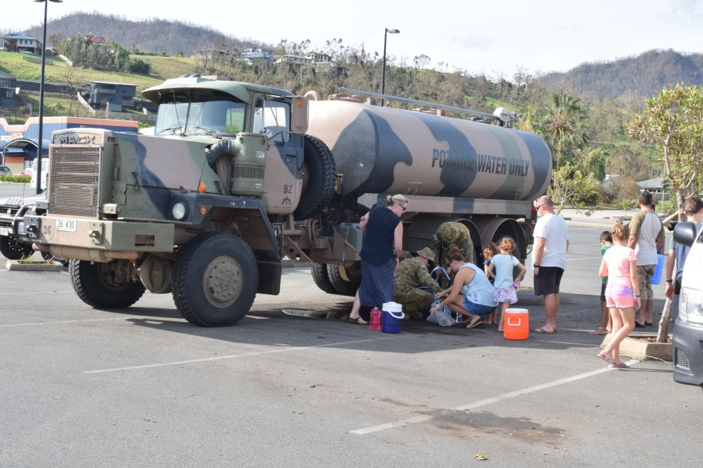 Airlie Beach residents line up for fresh water in the days following Cyclone Debbie