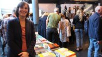 Historian Meredith Lake with her book, The Bible Down Under, and other Christian books, including the Bible, at Sydney Writers Festival.