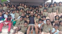 Naresh Kumar with schoolboys in his native Chennai