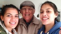 Claudia, aged 16, with grandfather Geoff Horne and her sister Francesca, 14.