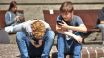 Boys Looking at mobile phones
