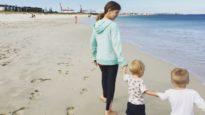 Children walk on beach