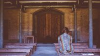 Woman in church alone