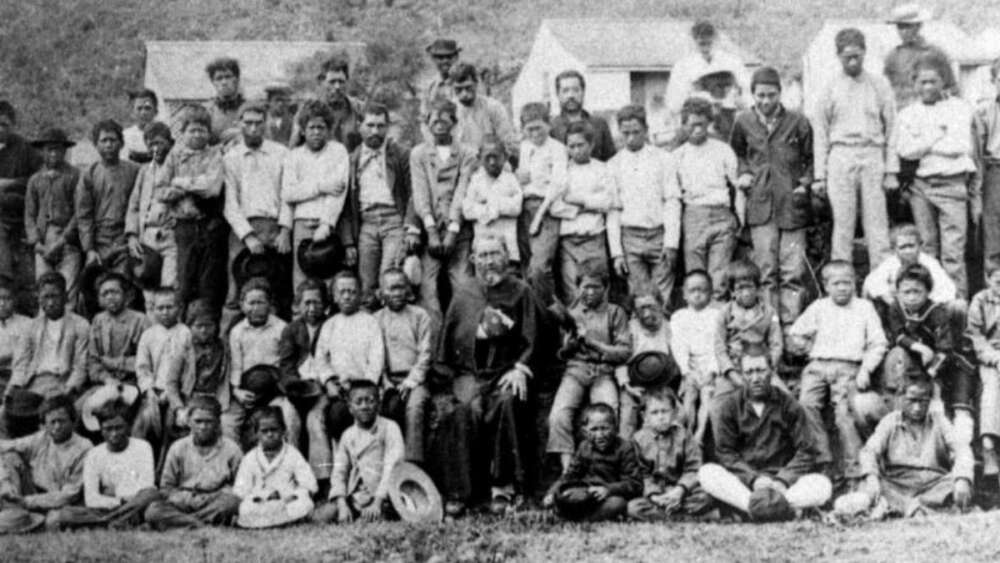 Father Damien and 64 boys of the leper settlement, taken in 1889, either late February or March, weeks before his death by William Brigham; only two exist from Brigham's visit this and portrait photo of Father Damien alone.