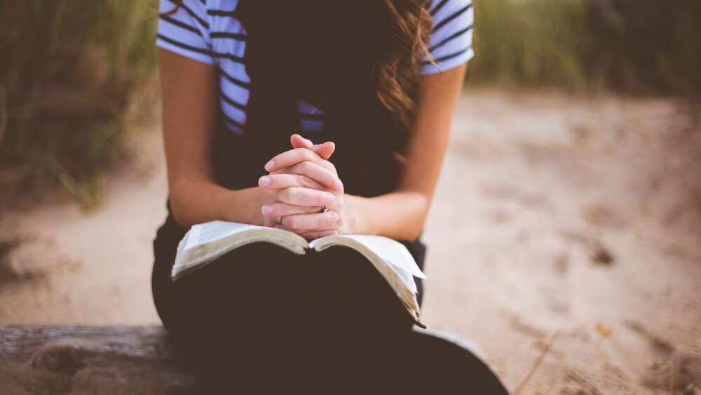 Woman meditating on Bible