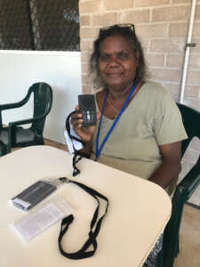 Wendy, holding a Megavoice player at the Kriol Workshop