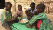Doudou Ltanoua (not seen in photo) school aged-children enjoy a hot meal cooked with food items provided by World Food Programme /Cameroon, Koza, Far North region, 30 April 2020 Image: Glory Ndaka for World Food Programme