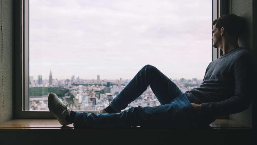 man hotel window isolation