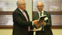 "PM Scott Morrison with Alphacrucis Colle'ges Stephen Fogarty and the Bible Society's ""Our Mob, God's Story""."