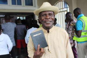 John Okolubo at Ogbia New Testament launch in Nigeria. Image: Bible Society Nigeria