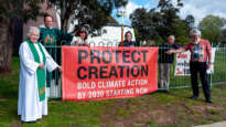 Leaders and worshippers at St Mary's Holy Cross Anglican Church Hackett, Canberra with their Faiths4climate banner.